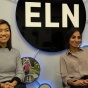 Pemba and Hemanta smile together in front of the ELN sign.