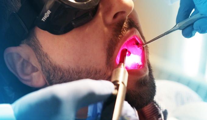dental exam using pink light.
