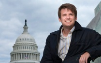 George Zornick, BA '05, in front of the capitol building in Washington, DC.