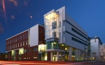 Photo of the New York State Center of Excellence in Bioinformatics and Life Sciences at night.