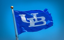 Blue UB flag blowing in the wind.