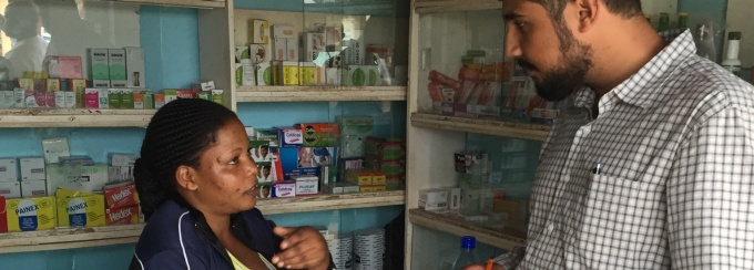 Industrial and Systems Engineering student Biplab Bhattacharya testing a survey tool with a drug shop owner in Uganda