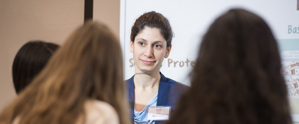 Photo of Pinar Okumus and prospective students