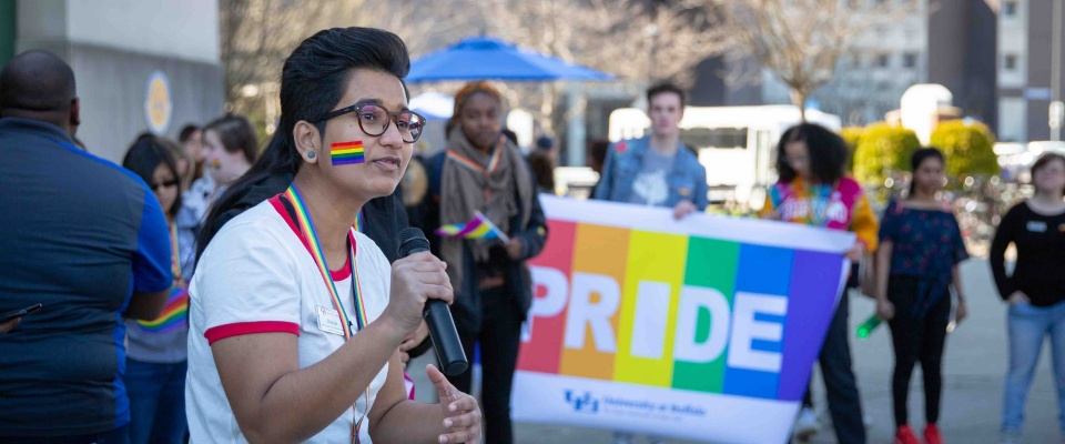 Student speaking at 2019 Pride Parade.