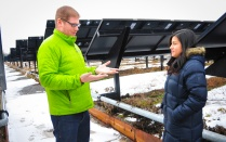 Discussing sustainability in front of solar panels