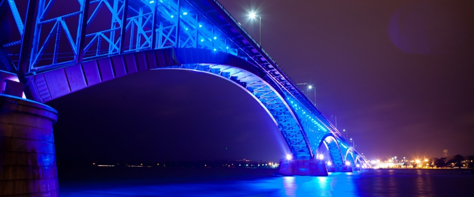 The Peace Bridge lit up in blue