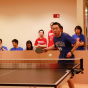Student playing ping pong.