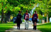 Female students walk on the South Campus