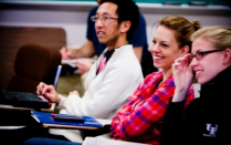 Students photographed in a classroom setting.