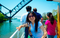 International students pictured on a boat on a local waterway.