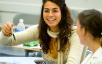 Two female students pictured in a classroom setting.