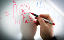 A math formula is pictured on a whiteboard