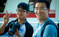 Two male international students smile for the camera