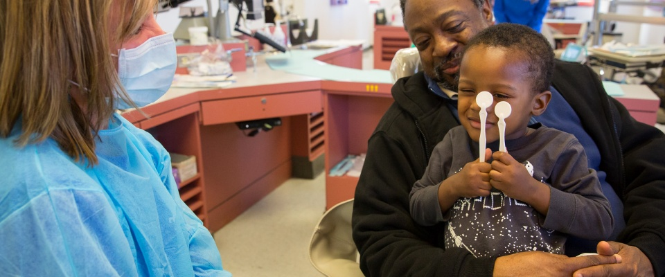 Buffalo community members during a free dental examination on Give Kids A Smile Day.