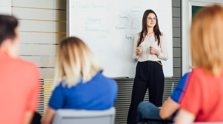 woman leading a training session.