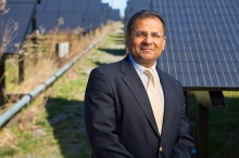 Headshot of Amit Goyal standing in front of UB's solar array.
