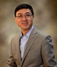Head shot of Jianqiang Wang, University at Buffalo expert on information science and information retrieval systems.