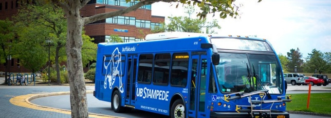 UB Stampede bus driving on campus.