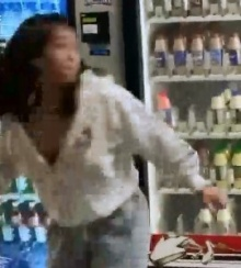 Unidentified Female who damaged a vending machine.