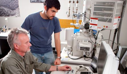Staff member and student in a lab.