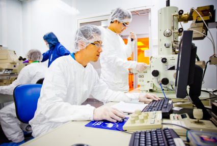 Researchers working in cleanroom.
