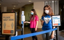 Students in line wearing face masks.