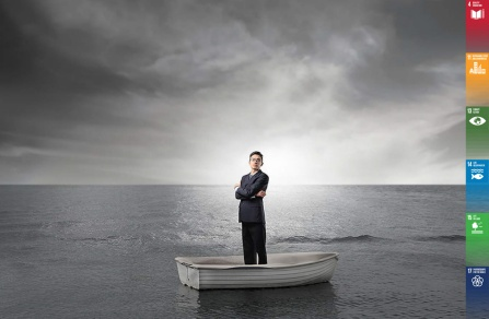A man standing on a raft.