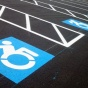 Parking spaces with accessibility signs.