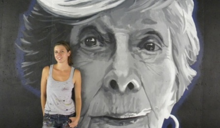Augustina Droze (MFA '15) in front of a mural.