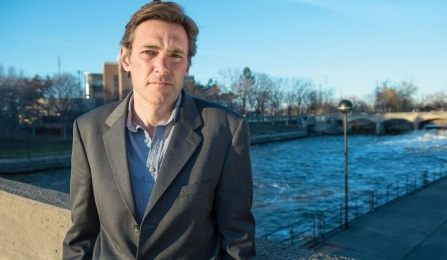 Marc Edwards by the Flint River in downtown Flint, Mich.