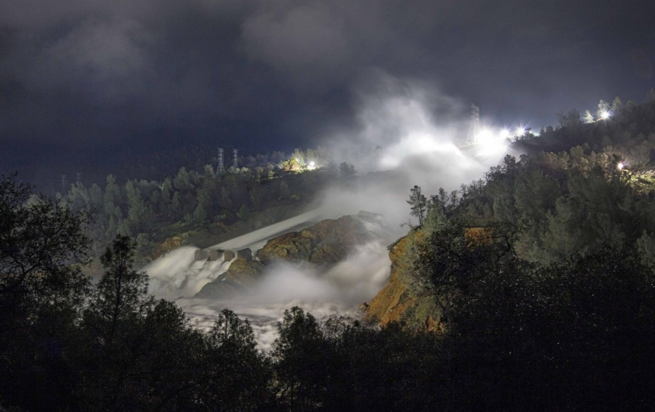 Night-time view of the massive breach of the Oroville Dam, February 2017. Image courtesy of the California Department of Water Resources.