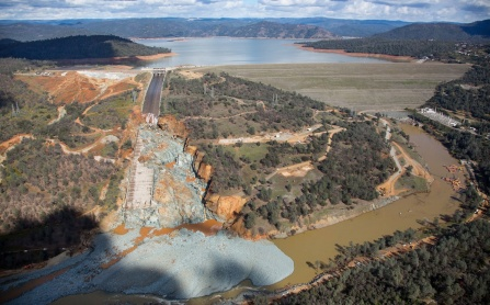 Aerial photo of the Oroville Dam site showing a huge debris field in the diversion pool area just below the damaged spillway. Image courtesy of Dale Kolke / California Department of Water Resources. Photo taken February 27, 2017.