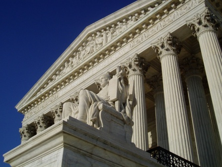 The marble sculpture, Authority of Law, appears below the inscription, EQUAL JUSTICE UNDER LAW, on the west entrance of the U.S. Supreme Court building. Photograph courtesy of CC BY-SA 3.0, Matt H. Wade.