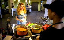 student being served food at c3 culinary center on north campus