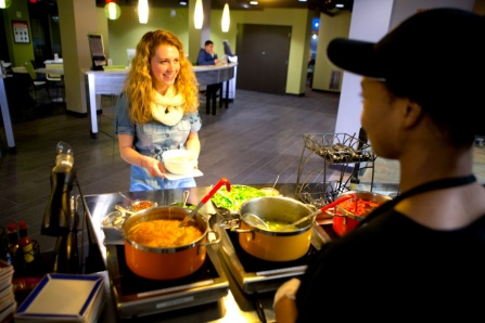 student being served food at c3 culinary center on north campus.