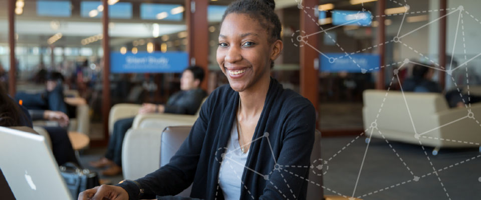 Whitney Singleton '17 sitting in the Capen Library.