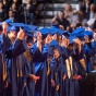 UB graduates in cap and gowns during commencement.