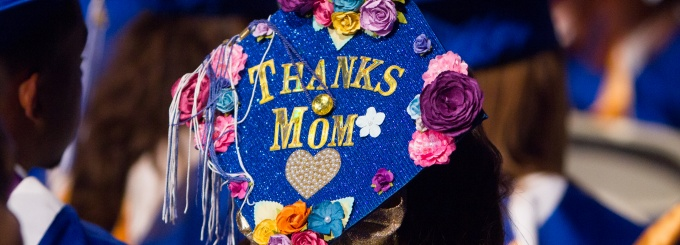 view of student's cap during graduation. caption: thanks mom