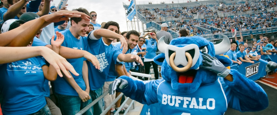 Photo of UB Bulls mascot, Victor E. Bull, with fans.