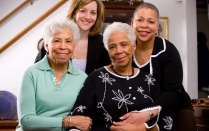 Image of older women with health care workers.