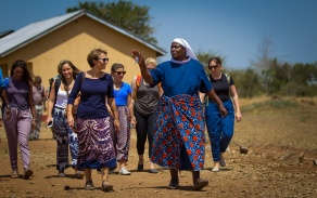 Mara Huber walking with community leader in Tanzania.
