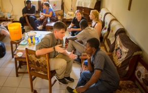 Student talking with community partner in Tanzania.