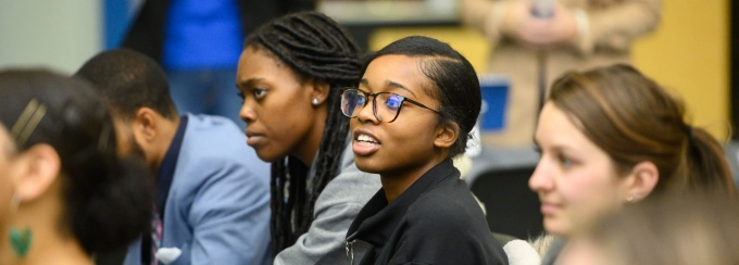 A faculty member and student sit inside the Blackstone LaunchPad office.