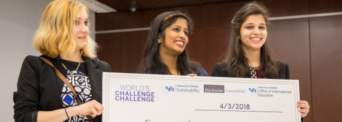 Students hold up their awards inside the Panasci Competition event.