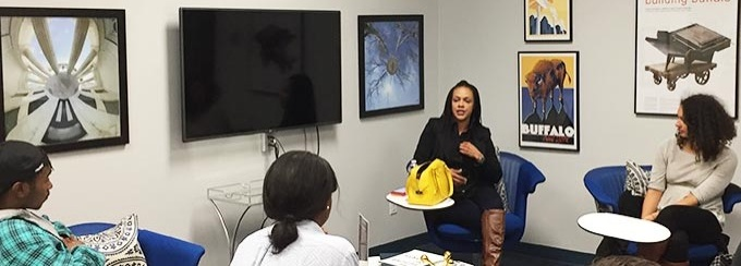A female entrepreneur speaks to students inside the Blackstone LaunchPad office.