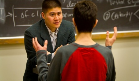 A faculty member talking to a student