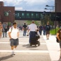 Students walking and traveling by wheelchair on the North Campus.