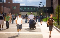 Students walking and traveling by wheelchair on North Campus