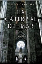 Book cover image depicting a stone cathedral with light coming through a circular window. The text La Catedral Del Mar appears in white letters over the image.