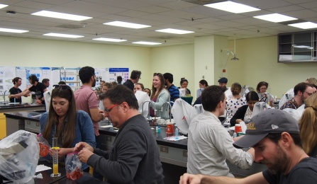 Members of the public learn how to extract DNA in a lab setting